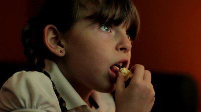 girl-watching-tv-w-popcorn